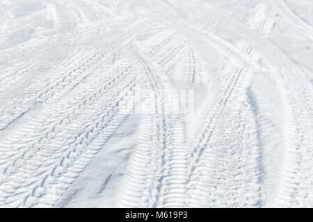 Car tire tracks on winter road. Background photo texture - Stock Photo