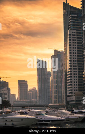 Dubai skyline at sundown, Dubai Marina, United Arab Emirates. - Stock Photo