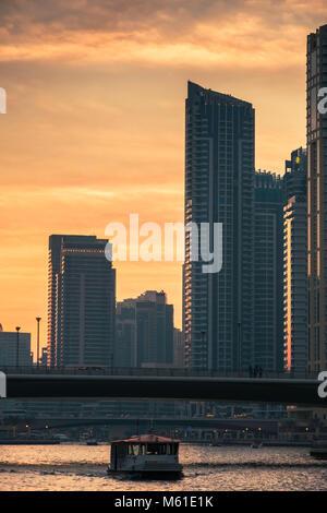 Dubai skyline at sundown, Dubai Marina, United Arab Emirates. - Stock Photo