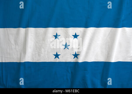 Honduras flag on the fabric texture. - Stock Photo