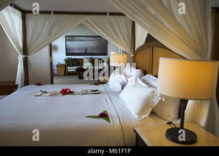Bedroom and bed of the Luxury villa, suit room, in The Residence Hotel in Zanzibar island a semi-autonomous part - Stock Photo