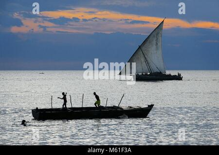 Local dhow boat in front ot the Stone Town beach, Zanzibar, Tanzania | usage worldwide - Stock Photo