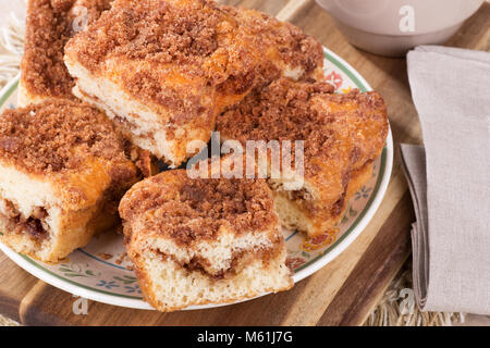 Closeup of sliced cinnamon swirl coffee cake on a plate - Stock Photo