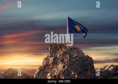 3d rendering of waving Kosovo flag on rocky landscape to celebrate the independence day of 17 February - Stock Photo