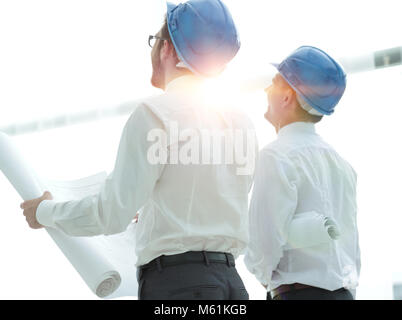 rear view.architect and Builder looking at blank screen - Stock Photo