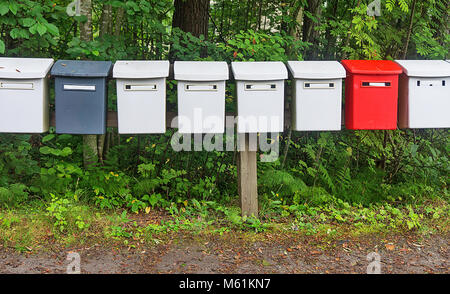 The row multicolored mailboxes in the park - Stock Photo