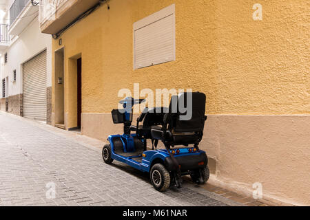 Mobility scooter in the street - Stock Photo