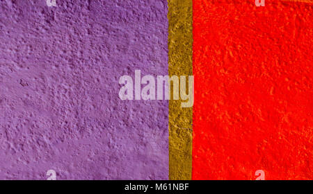 Painted in violet, red and gold color wall fragment - Stock Photo