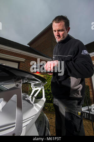 Car valeter detailing a Porsche sports car - Stock Photo