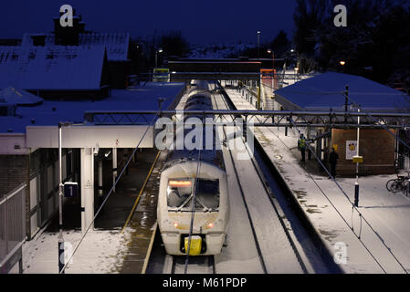 Train in snow. C2C railway train in Westcliff station covered with snow during the Beast from the East weather phenomenon. - Stock Photo