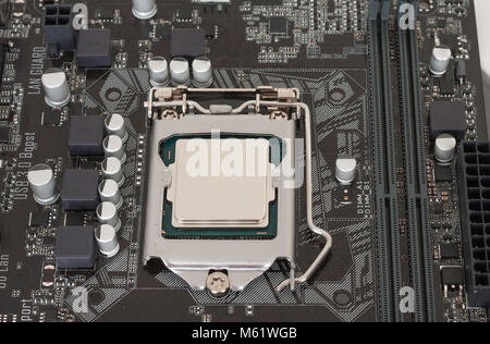 Close up of installed CPU processor on modern, new motherboard. - Stock Photo