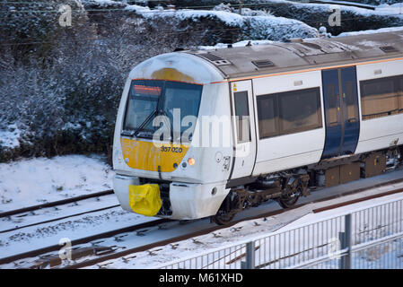 Train in snow. C2C railway train running through snow covered lines in Chalkwell near Southend on Sea, Essex. Beast - Stock Photo