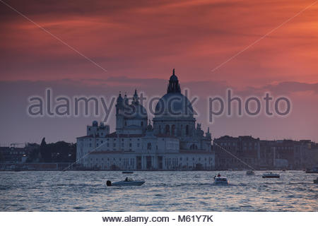 A dramatic sunset over the Roman catholic church, Santa Maria della Salute. - Stock Photo