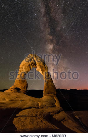 A starry night above the Delicate Arch with the Milky Way from Scorpius to Aquila. - Stock Photo