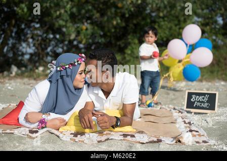happy family having a lovely picnic. family concept - Stock Photo