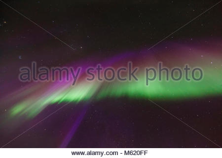 Colorful aurora crown or corona during an intense northern lights activity. - Stock Photo