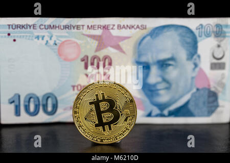 Single golden standing bitcoin and turkish lira on back - Stock Photo