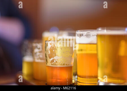 macro close up of a beer flight in sunlight at microbrewery in Chicago, Illinois - Stock Photo