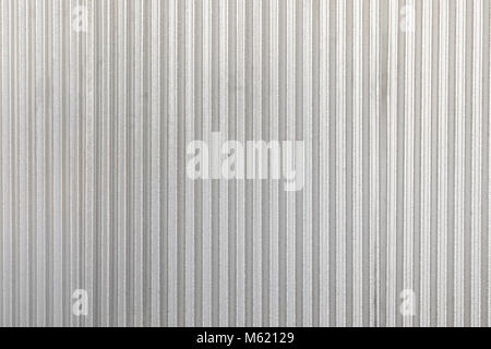 The corrugated grey metal wall background. Rusty zinc grunge texture and background. - Stock Photo