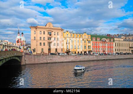 SAINT - PETERSBURG, RUSSIA - APRIL 9, 2016: Tourist boat on The Fontanka River near Panteleymonovsky Bridge and - Stock Photo