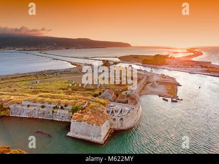 Sunset over Santa Maura - Agia Mavra Castle near Lefkada Town in Lefkada (Lefkas) Island Greece - Stock Photo