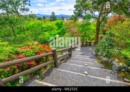 Arashiyama city panorama and aerial view of Tenryu-ji Zen Temple on the hill above the temple in the mountains on - Stock Photo