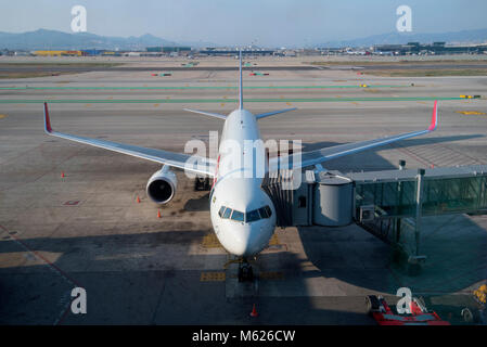 Looking out to airside at Barcelona airport - Stock Photo