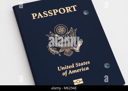 Expired and cancelled US Passport showing holes punched - USA - Stock Photo