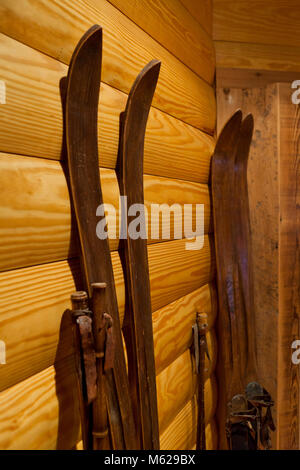 Vintage wooden skis against wall - USA - Stock Photo