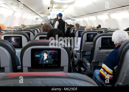 Coach seating (economy class) in an American Airlines Boeing 737 Next Gen passenger jet interior - USA - Stock Photo