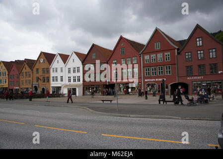 Bryggen is a row of hanseatic commercial buildungs along the eastern coastline of the fjord coming into the Norwegian - Stock Photo