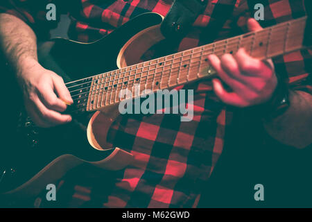guitarist in action duing a live concert - Stock Photo