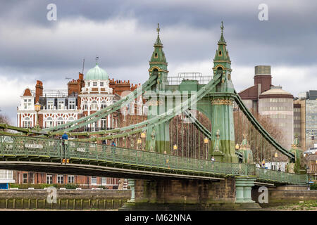 Hammersmith Bridge is a suspension bridge that crosses the River Thames in Hammersmith , West London - Stock Photo