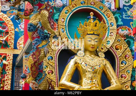 Buddha Amitayus golden statue at Namdroling Monastery in Bylakuppe, Karnataka, India. Tibetan Buddhist religion - Stock Photo