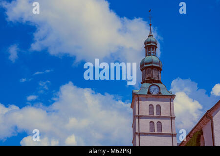 Close up of bellow tower and roof in a cloudy day at Megeve. A famous French ski resort located near the Mont Blanc - Stock Photo