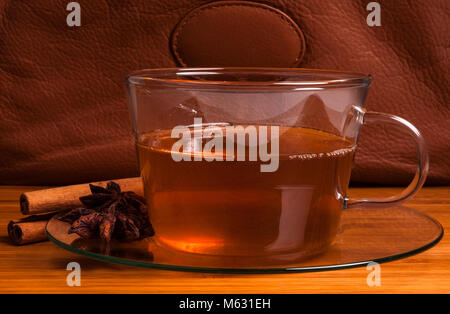 Cup of black tea on wood table - Stock Photo