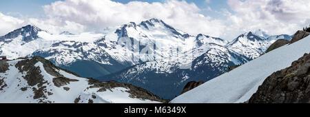 View of British Columbia mountain range peak from Whistler, Canada in summer - Stock Photo
