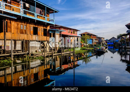 The fishermans houses are built on stilts between the swimming gardens in the village of Ywama on an island on Inle - Stock Photo