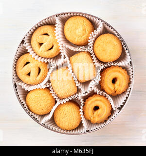 Overhead photo of Danish butter cookies in a tin - Stock Photo