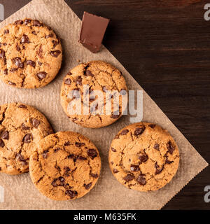 Chocolate chips cookies on baking paper with copyspace, square photo - Stock Photo