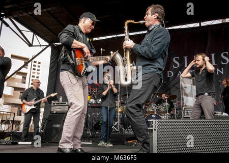 SAN DIEGO (Feb. 10, 2018) Hollywood actor and musician Gary Sinise and a member of the Lt. Dan Band entertain wounded - Stock Photo
