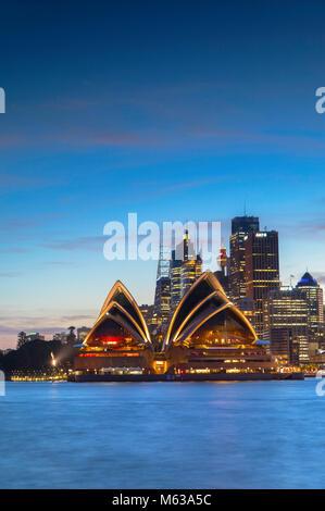 Sydney Opera House and skyline at sunset, Sydney, New South Wales, Australia - Stock Photo