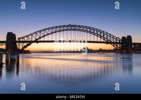 Sydney Harbour Bridge and Sydney Opera House at dawn, Sydney, New South Wales, Australia - Stock Photo