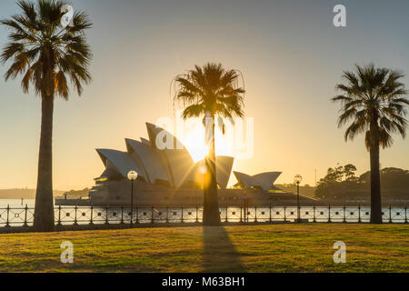 Sydney Opera House at sunrise, Sydney, New South Wales, Australia - Stock Photo