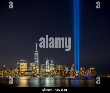 Tribute lights in New York Manhattan skyline 9/11 memorial event to remember the events of 11 September 2001 - Stock Photo