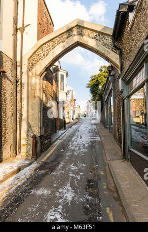 England, Broadstairs. Ice and snow on the road under the York Gate arch (c.1540). Bright sunshine with blue sky - Stock Photo