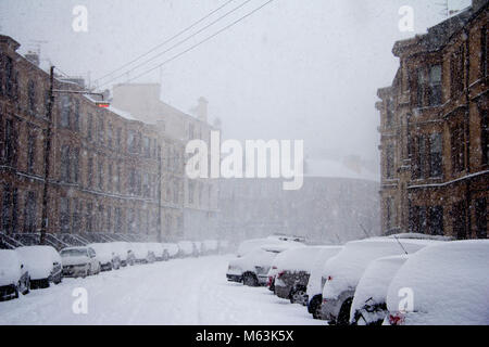 Glasgow, Scotland, UK. 28th Feb, 2018. After a lull in this morning's snow-storm, the Beast from the East resumes - Stock Photo