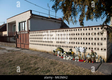 Velka Maca, Slovakia. 28th Feb, 2018. Flowers and candles are seen in front of the residence of murdered Slovak - Stock Photo