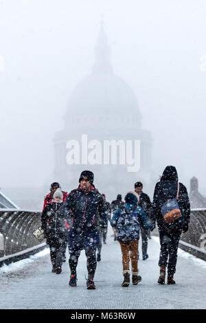 London, UK. 28th Feb, 2018. UK Weather: St. Paul's Cathedral seen from The Millennium Bridge during a snow blizzard. - Stock Photo