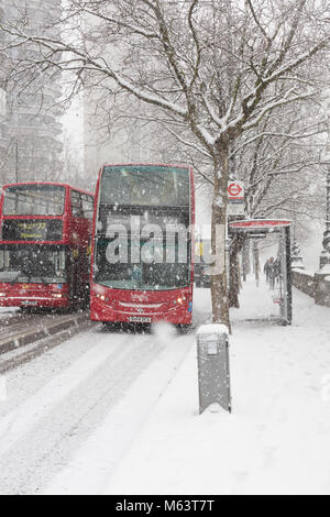 London, UK. 1st Mar, 2018. Two Red London Buses Carry on During the So Called 'Beast From the East' Storm - Stock Photo